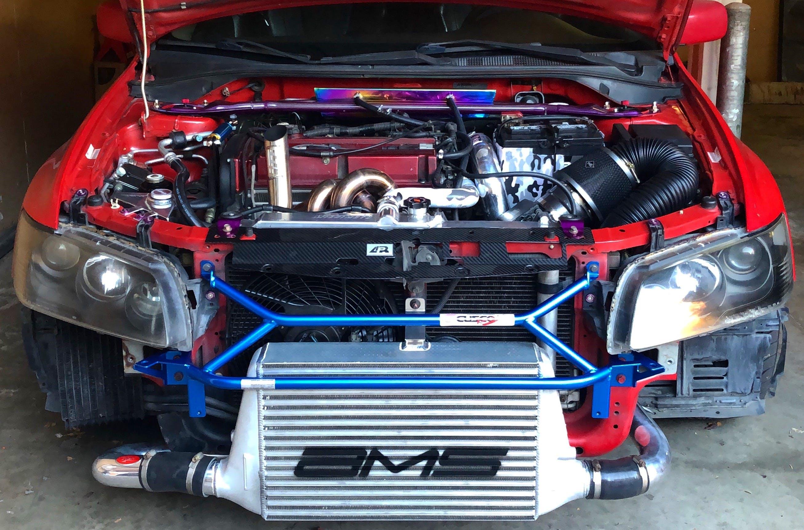 AMS Front Mount Intercooler w/ Logo | 2003-2007 Mitsubishi Evo 8 / 9 |  (AMS 01 09 0101-1)