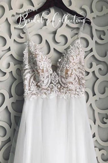 Spaghetti Straps Backless Appliques A-line Wedding Dresses