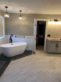 Wyndham Juno 63 Inch Freestanding Bathtub in Matte White with Matte Black Drain and Overflow Trim