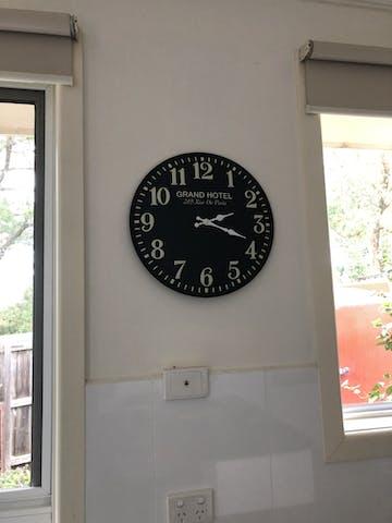 Grand Hotel Embossed Numbers Domed Metal Wall Clock, Black, 40cm