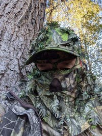 NWTF Mossy Oak Obsession | 3D Leafy Camo Mesh Back Hat with Front Face Concealment Adjustable